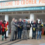 Kieran Sandwell with Cromer deputy mayor John Frosdick and members of the Walkers are Welcome group. Picture: DAVE ROBERTS